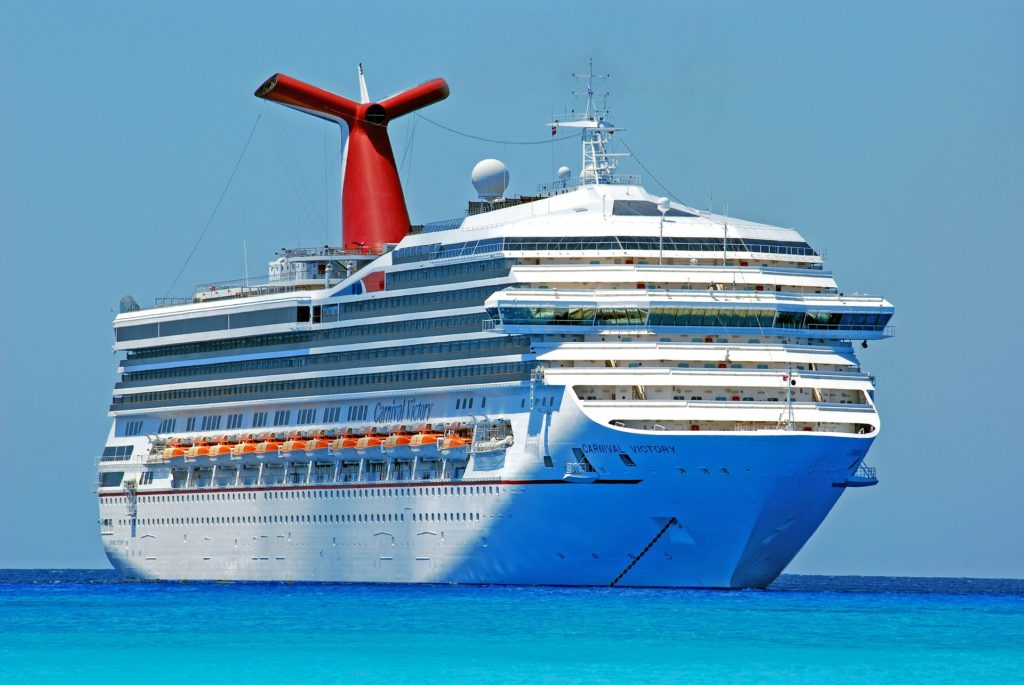 Cruise ship Carnival Victory dropped the anchor on deep blue ocean
